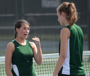 Wawasee's Jada Antonides and Sam Prins talk things over during a break in their No. 1 doubles match Friday night.