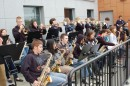 The Warsaw High School Jazz Band kept the crowd warm on a chilly morning as residents awaited the start of an outdoor ribbon-cutting and open house celebration of Warsaw's new City Hall location. The balcony on which the band performed formerly housed the building's HVAC system. (Photo by Jodi Magallanes)