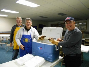 Despite the lack of a parade, Milford Kiwanians still held the annual Nelson's Chicken barbecue at Milford Community Center. From left are Milford Kiwanis members Clark Jones, Dick Roose and Chuck Bird.