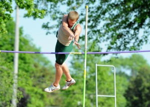 """Kevin Carpenter clears the pole vault bar at 11'0""""."""