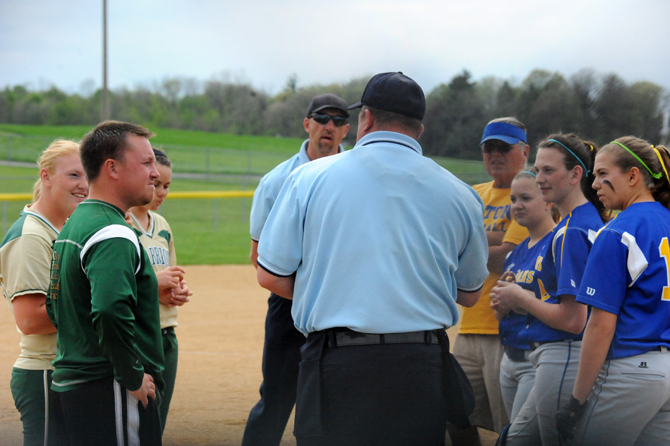 The captains and coaches from Wawasee and Triton meet with home plate umpire Brian Barger and field umpire Gene Teel before Tuesday's matchup. (Photos by Mike Deak)