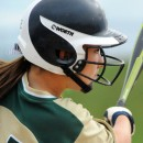 Wawasee's Paige Hlutke follows through on a double in the first inning.