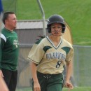 Wawasee's Cristina DeLaFuente heads to home plate as Triton catcher Allyson Brown looks on.