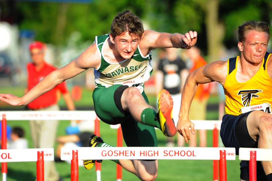 Clayton Cook of Wawasee flies over the 110-meter hurdles en route to a championship. (Photos by Mike Deak)