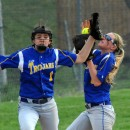 Triton fielders Brooke Roberts (1) and Krystal Sellers converge on a fly ball.