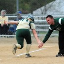 Madi Anderson gets a low five from Wawasee head coach Hans Griepentrog after hitting a home run.