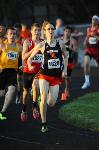 Warsaw's Robert Murphy leads the cavalcade around the turn during the 800-meter run. (Photos by Mike Deak)