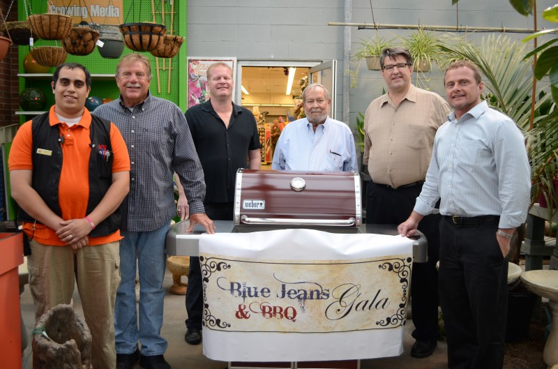 Ace Hardware of Warsaw has donated a Weber Genesis special edition grill for the silent auction that is part of the annual Blue Jeans and BBQ Gala to benefit Combined Community Services. From left are Josh Lainez of Ace Hardware; Jerry Ouding of The Spice Merchants and Olive Branch; John Tucker, Dane Miller and Gordy Clemens, celebrity chefs for the BBQ event; and Steve Possell, executive director of CCS. (Photo by Stacey Page)
