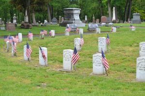Veterans graves are marked with American flags at Warsaw's Oakwood Cemetery for Memorial Day.