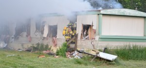 An abandoned mobile home on Sir Gallahad Drive in the Enchanted Hills park was ruled a total loss after a Wednesday night fire. (Photos by Stacey Page)