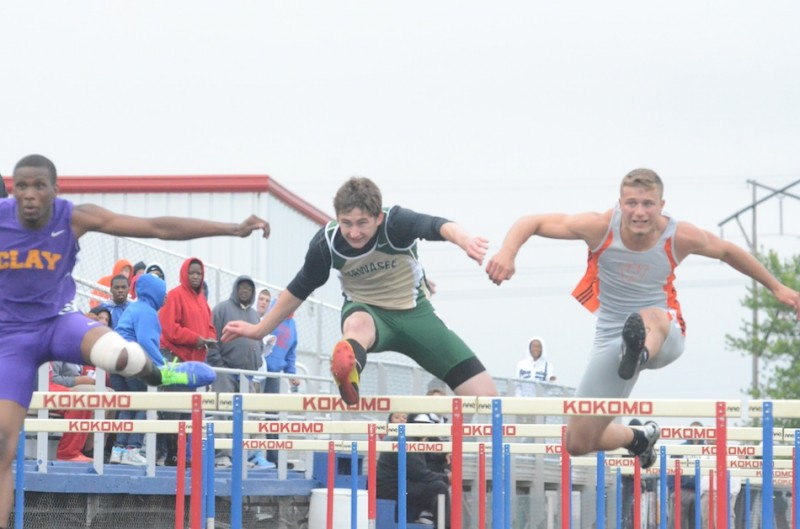 Wawasee sophomore Clayton Cook heads to a second-place finish in the 110 hurdles at the Kokomo Regional Thursday night. At right is Warsaw senior Taylor Cone, who placed third in the event. Both Cook and Cone advance to the State Finals June 1 (Photo by Scott Davidson)