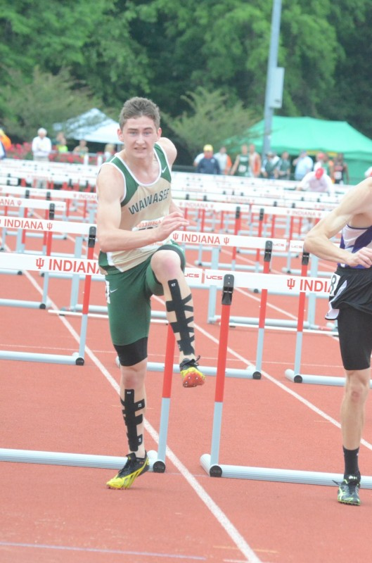 Wawasee sophomore Clayton Cook nears the finish line in the prelims of the 110 hurdles at the State Finals Friday (Photo by Scott Davidson)