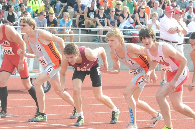 Warsaw senior stars Jake Poyner and Robert Murphy  prepare for the start of the 1,600 at the State Finals Friday night. The duo placed third and fourth respectively in the race to help the Tigers to a fifth-place team finish (Photos by Scott Davidson)