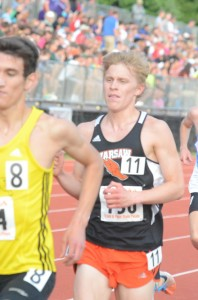 Jake Poyner races to a fifth-place finish in the 3,200 at the State Finals Friday night in Bloomington.