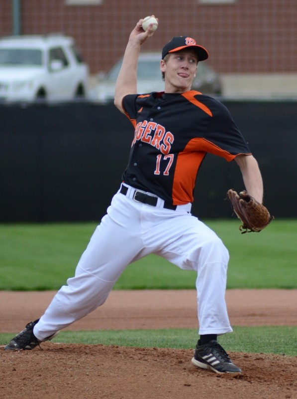 Warsaw senior Jason Ferguson fires a pitch earlier this season. The Tigers received the bye and will play host Elkhart Memorial in a sectional semifinal game on May 25 (File photo by Jim Harris)