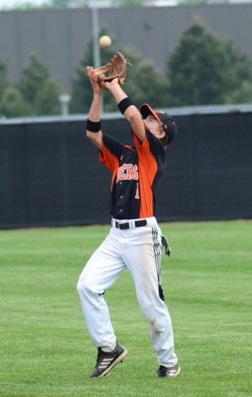 Josh Frantz gloves a popout for Warsaw during the Tiger Invitational Saturday.