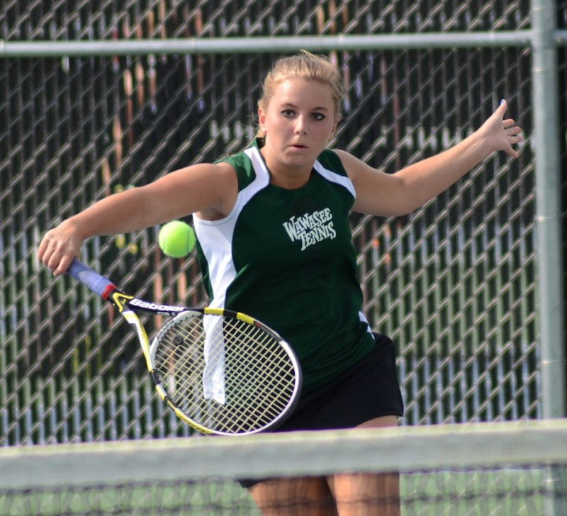 Esther Hermann of Wawasee makes a return during her victory at No. 1 singles in the sectional final at Warsaw Friday night.