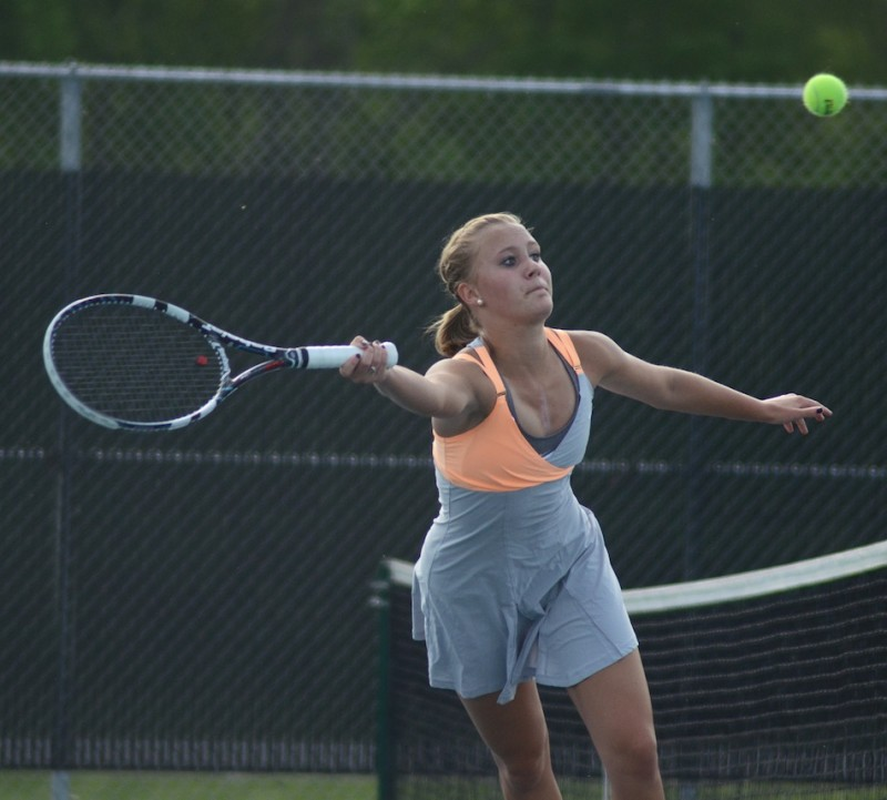 Camille Kerlin reaches for a shot for Warsaw Wednesday. Kerlin and Rosie Fleming were the heroes with the clinching point at No. 2 doubles in a 3-2 sectional win for the host Tigers (Photos by Jim Harris)