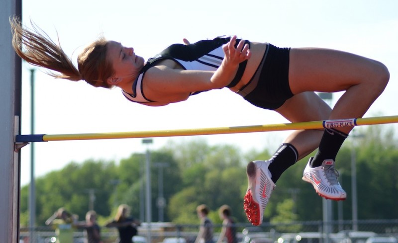 Senior Jamie Lacheta soared to a sectional championship in the high jump for Warsaw Tuesday night (Photos by Jim Harris)