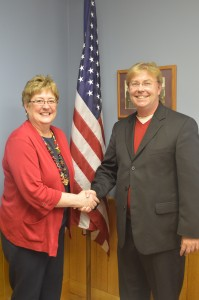 Rebecca Alles the new Van Buren Township Trustee is congratulated by County Republican Chairman Randy Girod