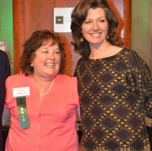 Cathy Fox, center, is shown with Amy Grant, Grammy award winner after receiving the Education Award