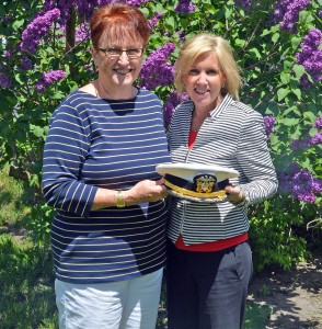 Kay Young receives the official Wawasee Flotilla commodore's hat from Holly Tuttle, flotilla committee chairwoman