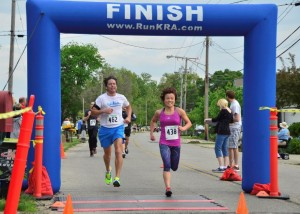 Yuko Baumann of Goshen was the overall women's winner, shown crossing the finish line with Joe Griner of North Webster.