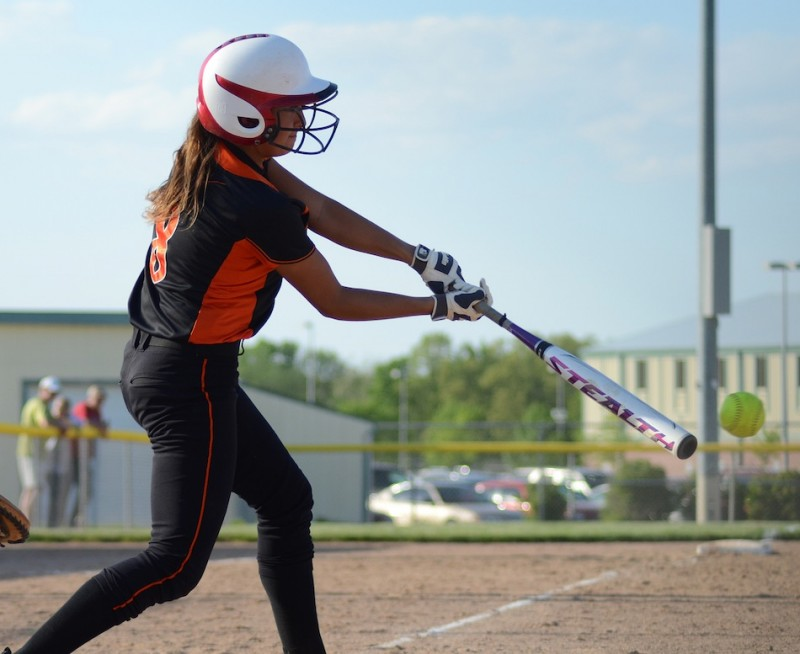 Ashley Ousley takes a rip for the Tigers Thursday night. The junior had three hits, including a home run, in a home loss to Elkhart Memorial.