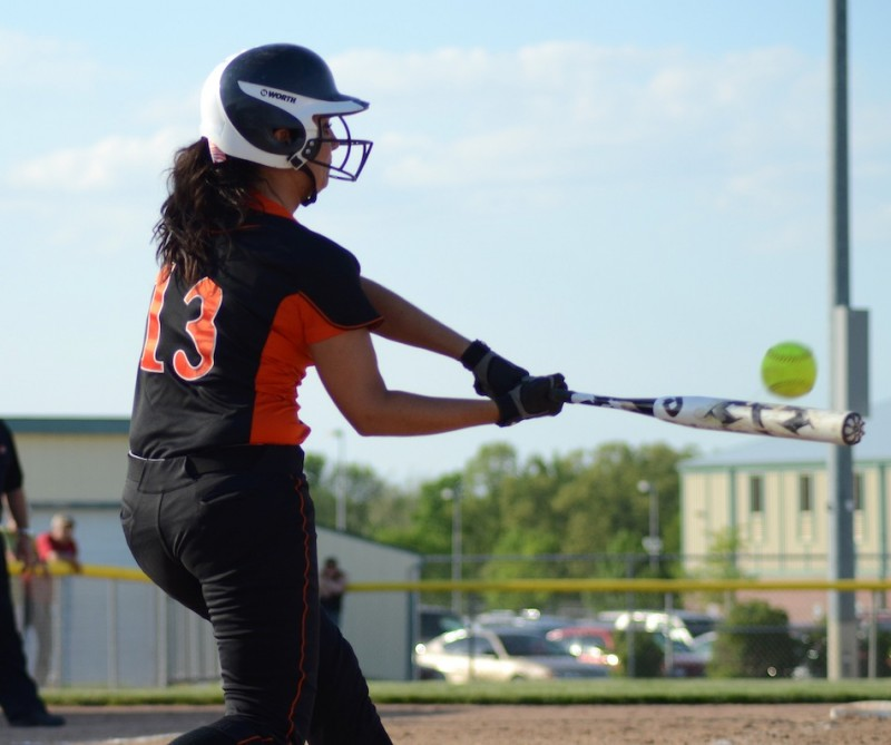 Warsaw's Kaleigh Speicher connects for a home run in a 15-10 NLC home loss to Elkhart Memorial Thursday night (Photos by Jim Harris)