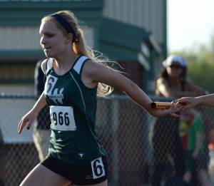 Sophomore Catherine Yankosky of Wawasee takes a handoff during the 4 X 100 relay Tuesday night.