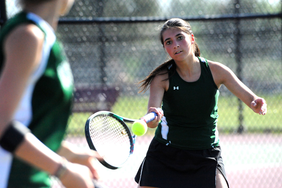 Wawasee's Jada Antonides returns a volley while one doubles teammate Sam Prins positions herself during their match at Whitko. (Photos by Mike Deak)
