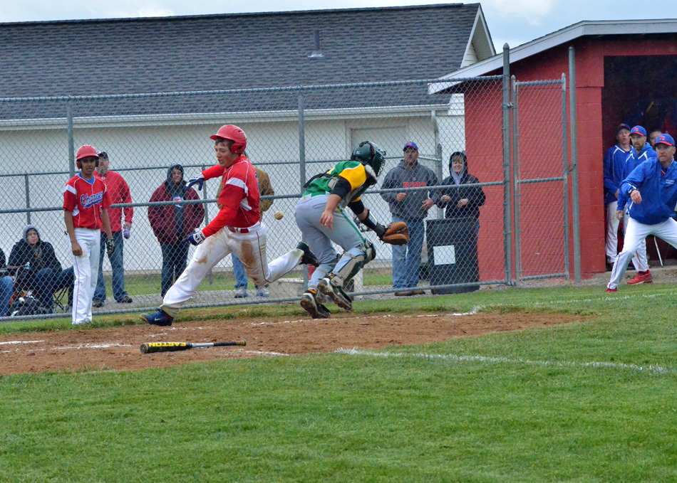 West Noble's Landon Stovers avoids a play at the plate while Tippecanoe Valley catcher Garrett Bell tries to corral the ball Thursday night. Stovers' run was big in a 4-1 West Noble win at the West Noble Baseball Sectional. (Photos by Nick Goralczyk)