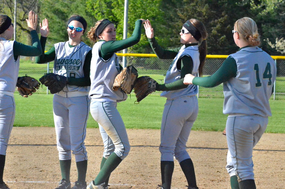 Wawasee's infield celebrates during a 3-1 win at Goshen. From left to right are Kylee Rostochak, Alli Ousley, Kylie Norris, Taylor Spangle and Madi Anderson.