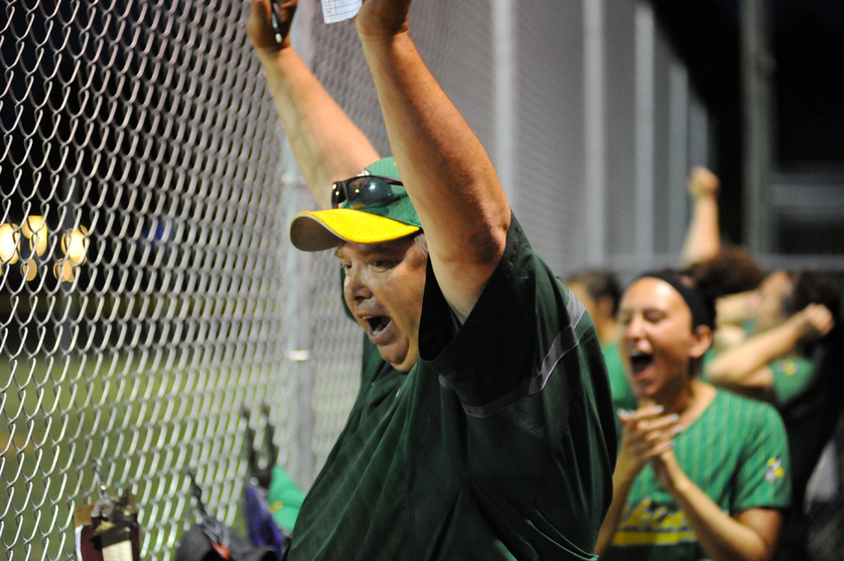 Tippecanoe Valley coach Chris Kindig celebrates with the dugout after his team knocked off NorthWood, 9-4, Monday night at the Lakeland Softball Sectional. (Photos by Mike Deak)