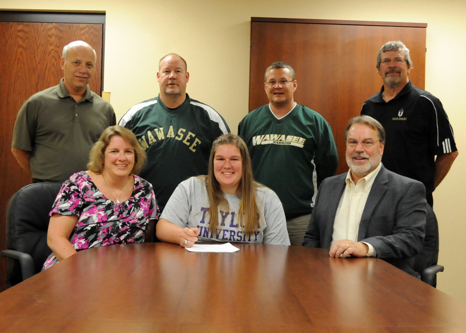 Wawasee High School senior Jordan Edington has chosen to continue her track and field career at Taylor University. Edington has starred in shot put. Pictured with Jordan in the front row are parents Michelle and Dr. Thomas Edington. In the back row are Wawasee athletic director Steve Wiktorowski, Wawasee throwing coach Scot McDowell, Wawasee track head coach Scott Lancaster and Taylor University women's track head coach Ted Bowers. (Photo by Mike Deak)