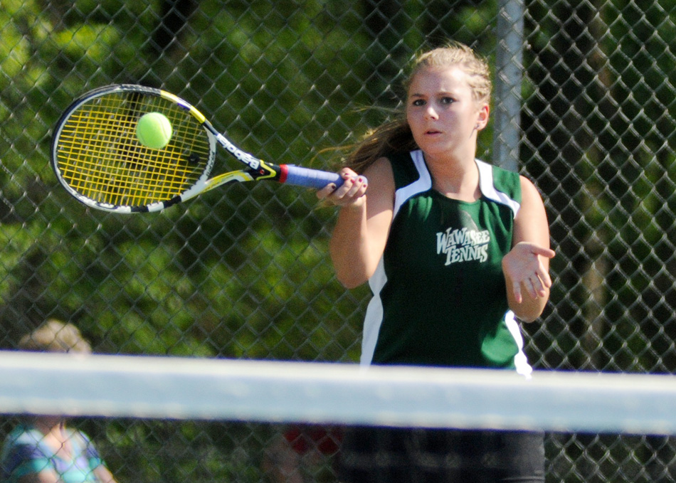 Wawasee's Esther Hermann concluded her first NLC Girls Tennis Championships with a win over Warsaw's Sarah Boyle Saturday afternoon. (Photos by Mike Deak)