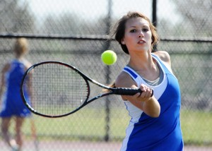 Whitko one singles player Abby Marshall times her return shot.