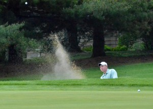 Wawasee's Jeffrey Moore blasts out of the sand during his round at the NLC.