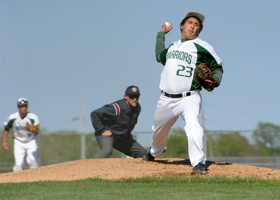 Wawasee pitcher Patrick Navarro deals against Goshen Monday night. The Redskins won the game 5-3. (Photos by Mike Deak)