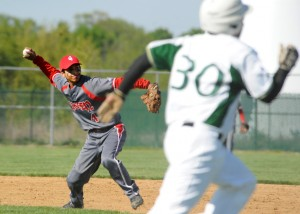 Goshen second baseman Jorge Pizana throws to first to get Wawasee's Nate Prescott out.