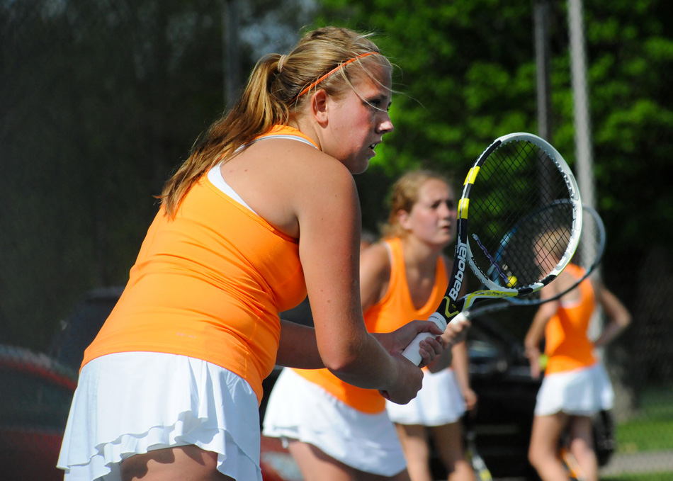 Warsaw's two doubles team of Mallory X and XX ready for play against NorthWood Wednesday in the first round of the Northern Lakes Conference girls tennis tournament. (Photos by Mike Deak)