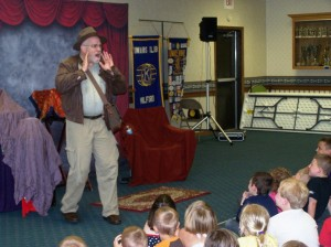 """Milford Public Library's kick off to their summer reading program was on Wednesday, June 5, at the Milford Community Building.  The program was """"Readers of the Lost Book"""" presented by Jack Strauss. It had magic, comedy and adventure!  The Fort Wayne Mad Ants mascot was also on hand to take pictures. (photo provided)"""