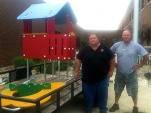 (Right) Tim Ellis of Reese Recreation Products Inc. stands with the $10,000 worth of playground equipment donated to Claypool Elementary during last night's WCS regular board meeting.  (Photo provided by Tim Ellis)