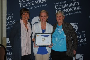 The North Webster Community Center received the The Non-profit Award at tonight's Heart of Gold Awards in Warsaw. Pictured, accepting the award, from left, are Jessica Hardy, Leah Gamble and Connie Adams. (Photo by Phoebe Muthart)