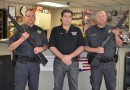 Fleck was in Warsaw just last month to accept a donation of guns for the Akron Police Department from Eagle Creek Firearms.  From left are Fleck, Eagle Creek Firearms owner Jay Jacobs, and Akron Police Officer Justin Gearhart. (Photo by Stacey Page)