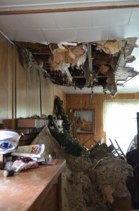 The living room ceiling in the home at 1405 Ranch Rd., Warsaw, has caved in rending the home uninhabitable. (Photos by Stacey Page)