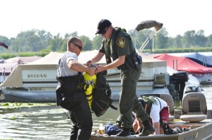 Indiana conservation officers prepared to dive in Little Chapman Lake Tuesday afternoon to recover the body of a drowning victim. (Photo by Stacey Page)