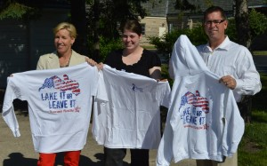 Holly Tuttle, Stacy Shery and Tom Tuttle show off the 2013 Wawasee Flotilla T-shirts which are now available