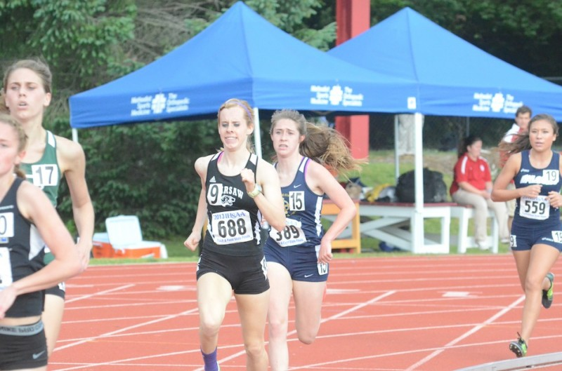 Warsaw senior Sarah Ray competes in the 1,600 at the State Finals Saturday night in Bloomington (Photos by Scott Davidson)