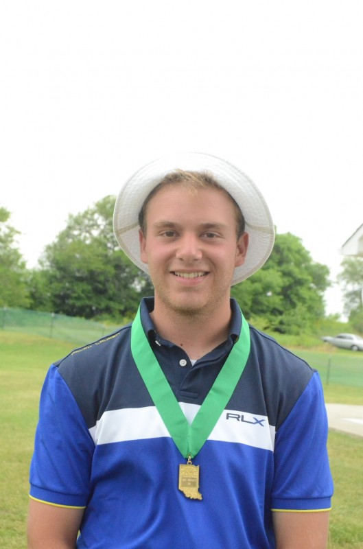 Ryan Rapp of Triton is all smiles as he proudly displays his medal after placing fifth at the State Finals in Franklin Wednesday.